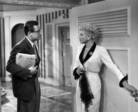 Billie (Judy Holliday) and Paul (William Holden) in Born Yesterday