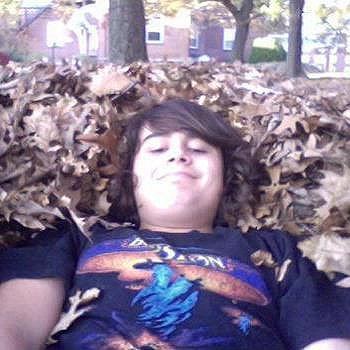At my high school they groundskeepers made a huge pile of leaves, so I buried my entire body in them, and went on my computer.  A few of my friends walked by and said to each other who the hell is that in there.  Then they saw it was me.  It was funny.  When I got out of the pile of leaves, I found 5 or 6 leaves in the ankle of my jeans.